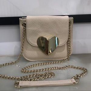 Urban Outfitters cream crossbody bag with heart